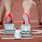 Detailed view of a sprinter wearing sprinting shoes with spikes,