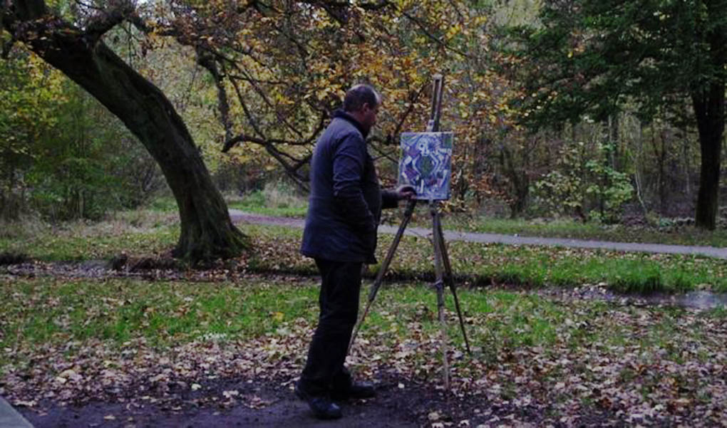 A man paints in nature, though not from nature, in a scene from the French documentary film The Woods Dreams Are Made Of (Le Bois Dont Les Rves Sont Faits).